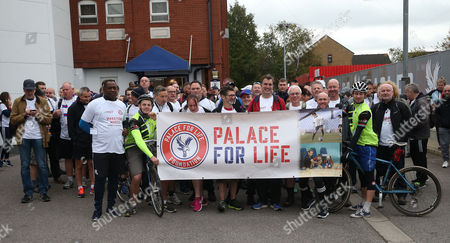 Crystal Palace fans and former Crystal Palace players Andrew Johnson and Andy Gray outside Selhurst Park Stadium at the Start of the Palace For Life Marathon March powered by Utilita, 7th October 2017 at Selhurst Park Stadium, Croydon, London.