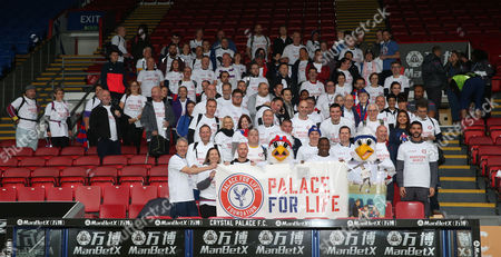 Stock Image of Crystal Palace fans and Julian Speroni, Former Crystal Palace player Andrew Johnson and Andy Gray along with Pete and Alice the eagles in the stands at Selnurst Park holding aloft The Palace For Life banner ahead of the Palace For Life Marathon March powered by Utilita, 7th October 2017 at Selhurst Park Stadium, Croydon, London.