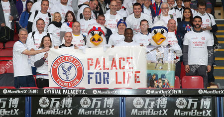Stock Picture of Crystal Palace fans and Julian Speroni, Former Crystal Palace player Andrew Johnson and Andy Gray along with Pete and Alice the eagles in the stands at Selnurst Park holding aloft The Palace For Life banner ahead of the Palace For Life Marathon March powered by Utilita, 7th October 2017 at Selhurst Park Stadium, Croydon, London.