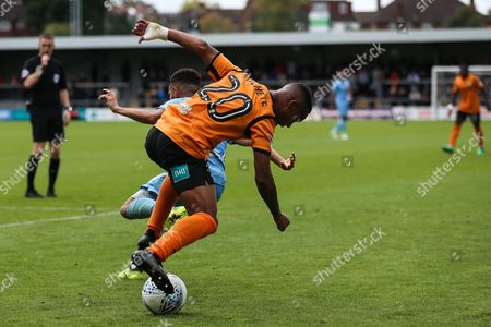 Stock Picture of Mauro Vilhete of Barnet turns Devon Kelly-Evans of Coventry City during the EFL Sky Bet League 2 match between Barnet and Coventry City at Underhill Stadium, London