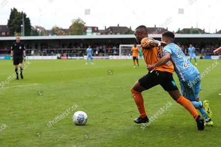 Devon Kelly-Evans of Coventry City (right) attempts to tackle Mauro Vilhete of Barnet during the EFL Sky Bet League 2 match between Barnet and Coventry City at Underhill Stadium, London