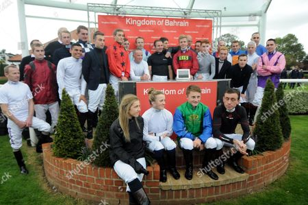 Jimmy Fortune with fellow jockeys after announcing his retirement from the saddle at Newmarket.