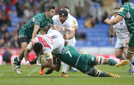 Valentino Mapapalangi of Leicester Tigers flies through a Blair Cowan of London Irish tackle