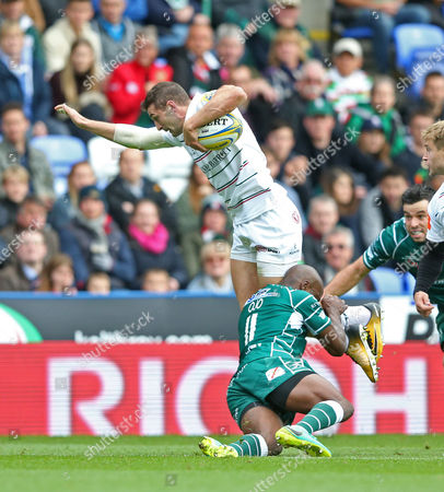 Jonny May of Leicester Tigers is tackled off his feet by Topsy Ojo of London Irish