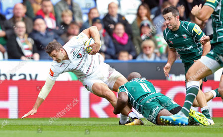 Jonny May of Leicester Tigers is tackled by Topsy Ojo of London Irish