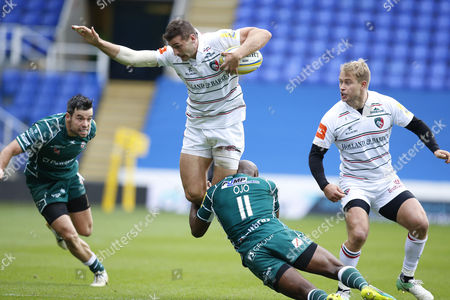 Jonny May of Leicester is tackled by Topsy Ojo of London Irish