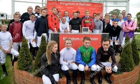 (C-black shirt) Jimmy Fortune, veteran jockey, who today announced his retirement, is feted by his fellow jockeys after his last race.