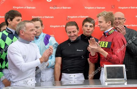 (C) Jimmy Fortune, veteran jockey, who today announced his retirement, is feted by his fellow jockeys after his last race.