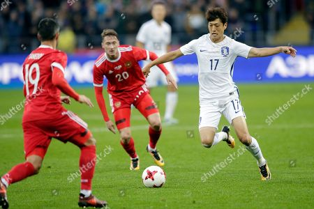 Kyungwon Kwon. South Korea's Chung-Yong Lee, right, challenges Russia's Anton Miranchuk, center, for the ball during the international friendly soccer match between Russia and South Korea in Moscow, Russia
