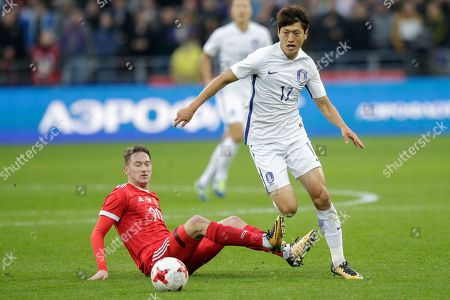 Chung-Yong Lee, Anton Miranchuk. South Korea's Chung-Yong Lee, right, challenges Russia's Anton Miranchuk for the ball during the international friendly soccer match between Russia and South Korea in Moscow, Russia