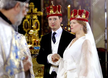 Prince Philip of Yugolsavia (C) and his bride, Serbian painter Danica Marinkovic (R) during their wedding ceremony at the St. Michael's Cathedral in Belgrade, Serbia, 07 October 2017. The prince also known as Filip Karadjordjevic is the son of Prince Alexander of Yugoslavia and Princess Maria da Gloria.
