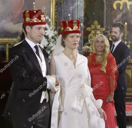 Prince Philip of Yugolsavia (L) and his bride, Serbian painter Danica Marinkovic (R) during their wedding ceremony at the St. Michael's Cathedral in Belgrade, Serbia, 07 October 2017. The prince also known as Filip Karadjordjevic is the son of Prince Alexander of Yugoslavia and Princess Maria da Gloria.