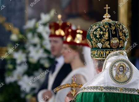 Serbian Orthodox Church Patriarch Irinej, right, performs the wedding ceremony of Prince Philip Karadjordjevic, of the dethroned Serbian royals, and his wife Danica Marinkovic in Belgrade's Congregational church in Serbia, . Prince Philip is one of the sons of Crown Prince Aleksandar Karadjordjevic, the heir to Serbia's now-defunct throne