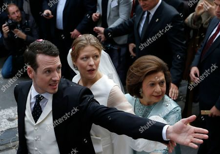 Prince Philip Karadjordjevic, of the dethroned Serbian royals, and his wife Danica Marinkovic leave Belgrade's Congregational church in Serbia, after their wedding ceremony, with Crown Princess Katherine, right, . Prince Philip is one of the sons of Crown Prince Aleksandar Karadjordjevic, the heir to Serbia's now-defunct throne