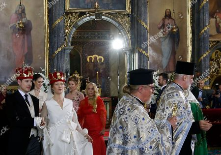 Stock Photo of Prince Philip Karadjordjevic, of the dethroned Serbian royals, left, and his wife Danica Marinkovic during their wedding ceremony in Belgrade's Congregational church in Serbia, . Prince Philip is one of the sons of Crown Prince Aleksandar Karadjordjevic, the heir to Serbia's now-defunct throne