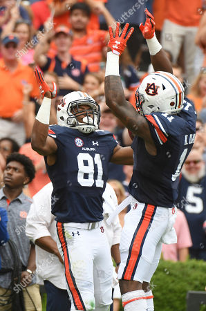 Darius Slayton, Kyle Davis. Auburn wide receivers Darius Slayton (81) and Kyle Davis (11) celebrate after Slayton's touchdown during the first half of an NCAA college football game against Mississippi in Auburn, Ala