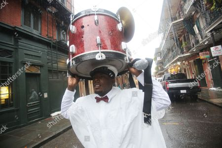 Sam Jackson walks his drum through the rain in the French Quarter as Hurricane Nate approaches New Orleans, Louisiana, USA on 7 October 2017. Reports state that a state of emergency has been declared in Louisiana, Mississippi, Alabama and parts of Florida as Nate is expected to make US landfall as a category two hurricane.