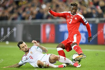 Switzerland's Jacques Francois Moubandje (R) fights for the ball with with Hungary's Roland Ugrai during the 2018 FIFA World Cup Group B qualification soccer match between Switzerland and Hungary in the St. Jakob-Park stadium in Basel, Switzerland, 07 October 2017.