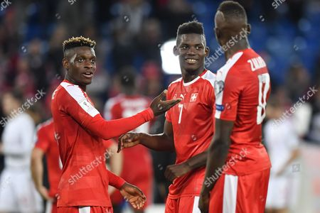 (L-R) Switzerland's Jacques Francois Moubandje, Breel Embolo and Denis Zakaria react after the 2018 FIFA World Cup Group B qualification soccer match between Switzerland and Hungary in the St. Jakob-Park stadium in Basel, Switzerland, 07 October 2017.