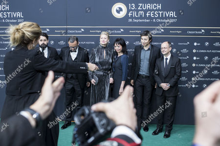 The Jury of the Award Night ceremony (L-R) Lucas Ochoa, Michel Merkt, Trine Dyrholm, Mabel Cheung, Paul Negoescu and Ed Guiney pose on the Green Carpet at the 13th Zurich Film Festival (ZFF) in Zurich, Switzerland, 07 October 2017. The festival runs from 28 September to 08 October.