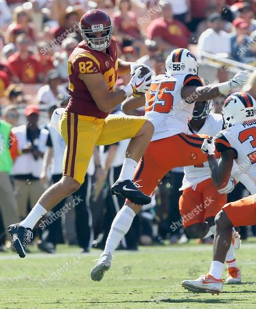 Tyler Petite, Manase Hungalu, Jalen Moore. Southern California tight end Tyler Petite (82) catches a first down reception over Oregon State linebacker Manase Hungalu (55) and safety Jalen Moore (33) during the first half of an NCAA college football game in Los Angeles