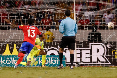 Honduras goalkeeper Luis Lopez looks as the ball enter his goal as Costa Rica's Rodney Wallace, right, celebrates the goal scored by his teammate Kendall Waston during a World Cup qualifying soccer match at the National Stadium in San Jose, Costa Rica
