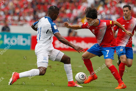 Honduras' Bryan Beckeles, left, fights for the ball with Costa Rica's Christian Bolanos during a World Cup qualifying soccer match at the National Stadium in San Jose, Costa Rica