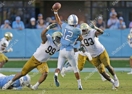 Chazz Surratt, Jay Hayes, Jerry Tillery. Notre Dame's Jerry Tillery (99) and Jay Hayes (93) rush North Carolina quarterback Chazz Surratt (12) during the second half of an NCAA college football game in Chapel Hill, N.C., . Notre Dame won 33-10