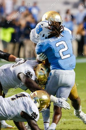 Jay Hayes (93) of the Notre Dame Fighting Irish tackles Jordon Brown (2) of the North Carolina Tar Heels in the fourth quarter of the NCAA matchup between Notre Dame and North Carolina at Kenan Memorial Stadium in Chapel Hill, NC