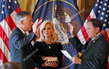 Jon Huntsman Jr., Gary Herbert, Mary Kaye Huntsman. Jon Huntsman Jr., left, the new U.S. ambassador to Russia, raises his hand during a ceremonial swearing-in event with Utah Gov. Gary Herbert, while his wife Mary Kaye holds the Bible, in Salt Lake City