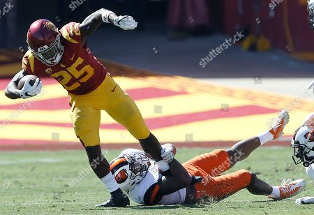 Jalen Moore, Ronald Jones II. Oregon State safety Jalen Moore, right, holds onto Southern California running back Ronald Jones II during the first half of an NCAA college football game in Los Angeles
