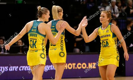 Australia's Stephanie Wood, right, congratulates teammates Courtney Bruce, left, and April Brandley after defeating New Zealand 60-52 in their Constellation Cup netball test in Christchurch, New Zealand