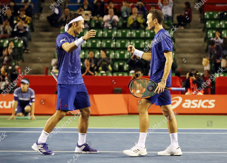 Japanese pair Yasutaka Uchiyama (L) and Ben McLachlan celebrate their victory against Santiago Gonzalez of Mexico and Julio Peralta of Chile pair during the semi final of doubles of the Rakuten Japan Open tenni championships in Tokyo on Saturday, October 7 2017. Japanese pair won the match 7-5, 6-4.