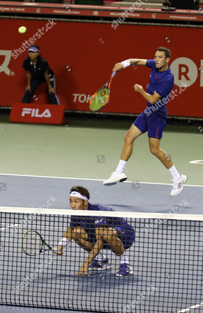 Japanese pair Yasutaka Uchiyama (L) and Ben McLachlan return the ball against Santiago Gonzalez of Mexico and Julio Peralta of Chile pair during the semi final of doubles of the Rakuten Japan Open tenni championships in Tokyo on Saturday, October 7 2017. Japanese pair won the match 7-5, 6-4.