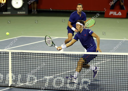 Japanese pair Yasutaka Uchiyama (R) and Ben McLachlan return the ball against Santiago Gonzalez of Mexico and Julio Peralta of Chile pair during the semi final of doubles of the Rakuten Japan Open tenni championships in Tokyo on Saturday, October 7 2017. Japanese pair won the match 7-5, 6-4.