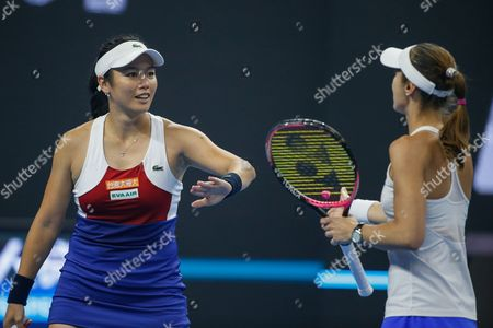 Martina Hingis (R) of Switzerland and Yung-Jan Chan (L) of Taiwan react during their women's doubles final match against Timea Babos of Hungary and Andrea Hlavackova of the Czech Republic at the China Open tennis tournament at the National Tennis Center in Beijing, China, 08 October 2017.