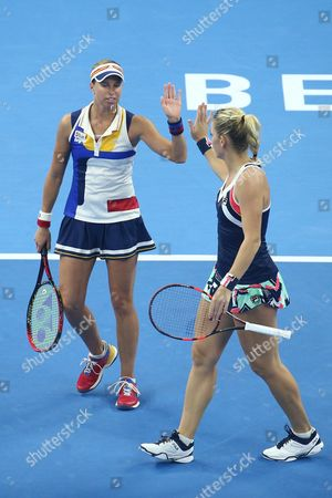 Timea Babos of Hungary (R) and Andrea Hlavackova of Czech Republic react as they compete against Yung-Jan Chan of Chinese Taipei and Martina Hingis of Switzerland during their women's doubles final match of the China Open tennis tournament at the National Tennis Center in Beijing, China, 08 October 2017.