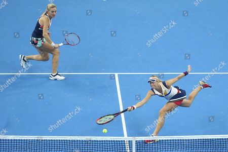 Timea Babos of Hungary (L) and Andrea Hlavackova of Czech Republic in action against Yung-Jan Chan of Chinese Taipei and Martina Hingis of Switzerland during their women's doubles final match of the China Open tennis tournament at the National Tennis Center in Beijing, China, 08 October 2017.