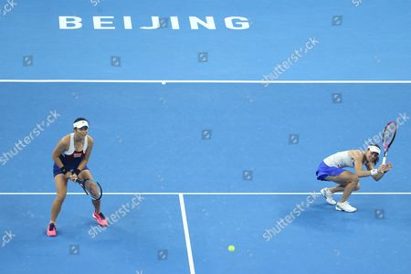 Yung-Jan Chan of Chinese Taipei (L) and Martina Hingis of Switzerland in action against Timea Babos of Hungary and Andrea Hlavackova of Czech Republic during their women's doubles final match of the China Open tennis tournament at the National Tennis Center in Beijing, China, 08 October 2017.