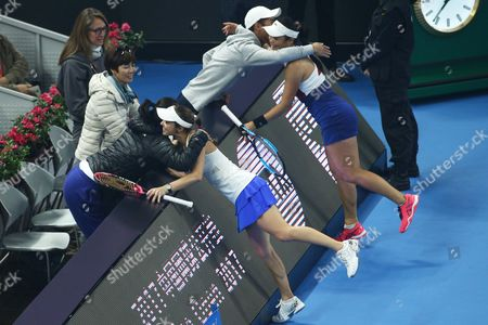 Yung-Jan Chan of Chinese Taipei and Martina Hingis of Switzerland celebrate with their coaches after winning the women's doubles final match of the China Open tennis tournament defeating Timea Babos of Hungary and Andrea Hlavackova of Czech Republic at the National Tennis Center in Beijing, China, 08 October 2017.