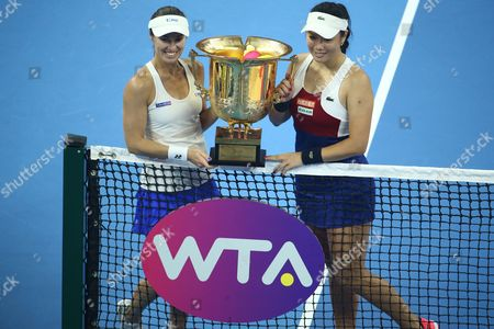 Yung-Jan Chan of Chinese Taipei (R) and Martina Hingis of Switzerland pose with their trophy after winning the women's doubles final match of the China Open tennis tournament defeating Timea Babos of Hungary and Andrea Hlavackova of Czech Republic at the National Tennis Center in Beijing, China, 08 October 2017.