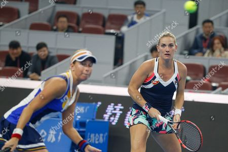 Timea Babos (R) of Hungary and Andrea Hlavackova (L) of the Czech Republic in action during their women's doubles final match against Martina Hingis of Switzerland and Yung-Jan Chan of Taiwan at the China Open tennis tournament at the National Tennis Center in Beijing, China, 08 October 2017.