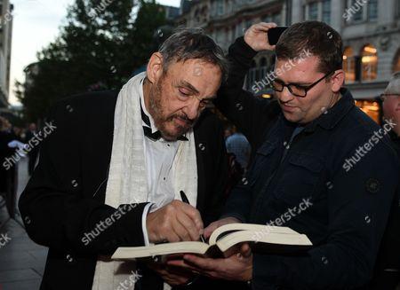 John Rhys-Davies signs an autograph