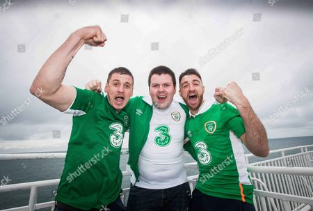 Ireland fans Stephen Burke, Tom Duennan and Ian Burke from Marino onboard the ferry to Holyhead
