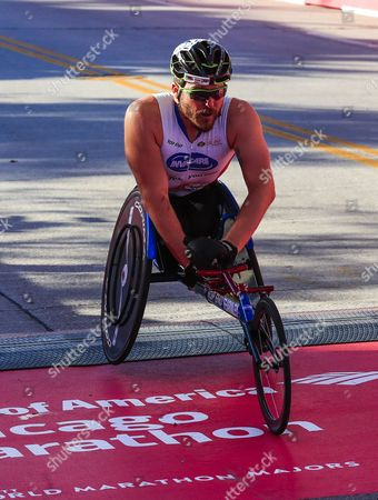 Kurt Fearnley of Australia crosses the finish line to finish second in the wheelchair portion of the 40th running of the Chicago Marathon in Chicago, Illinois, USA, 08 October 2017. Nearly 40,000 people from all 50 states and more than 100 countries registered for the event that is one of the world's major marathons.