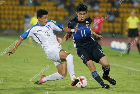 Japan's Taisei Miyashiro, 11 and Honduras' Santiago Cabrera duel for the ball the FIFA U-17 World Cup match in Gauhati, India, Sunday, Oct.8, 2017