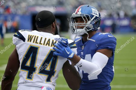 Los Angeles Chargers running back Andre Williams (44) and New York Giants running back Shane Vereen (34) talk prior to an NFL football game, in East Rutherford, N.J