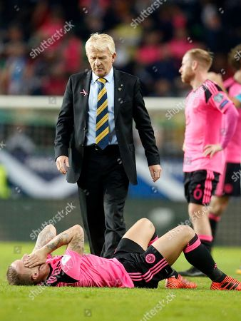 Scotland coach Gordon Strachan looks at Scotland's Leigh Griffiths, bottom, after the World Cup Group F qualifying soccer match between Slovenia and Scotland, at the Stozice stadium in Ljubljana, Slovenia