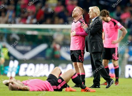 Scotland coach Gordon Strachan comforts Scotland's Barry Bannan during the World Cup Group F qualifying soccer match between Slovenia and Scotland, at the Stozice stadium in Ljubljana, Slovenia