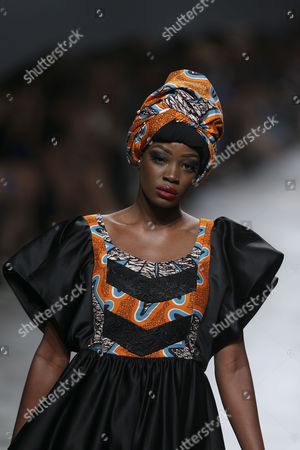 Stock Picture of A model displays a creation by fashion designer Nadir Tati from Angola during her runway show at Lisbon Fashion Week, at Carlos Lopes Pavillion in Lisbon, Portugal, 08 October 2017.